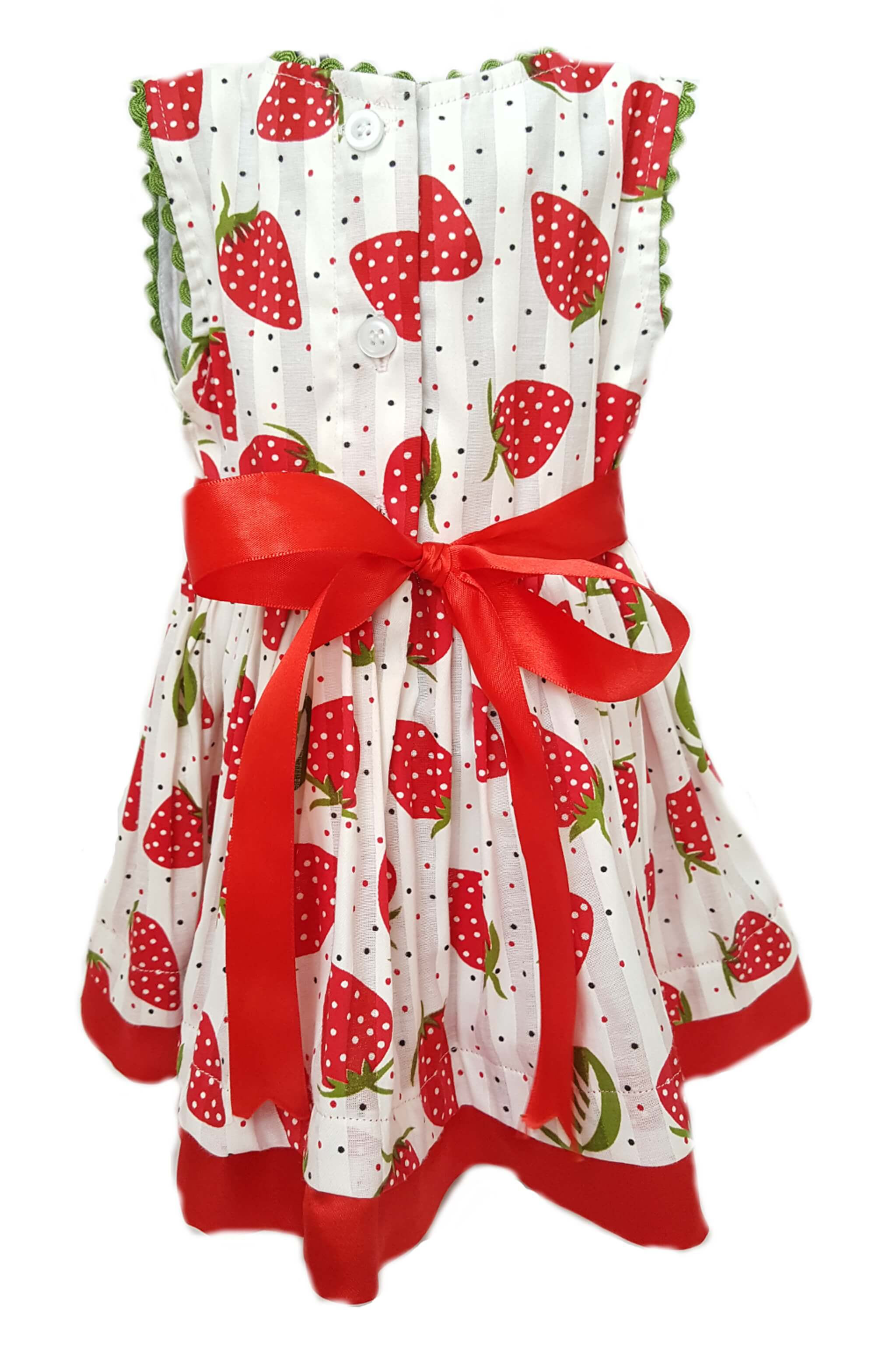 Back of strawberry print dress with red satin trim and sash to tie at waist for a little girl
