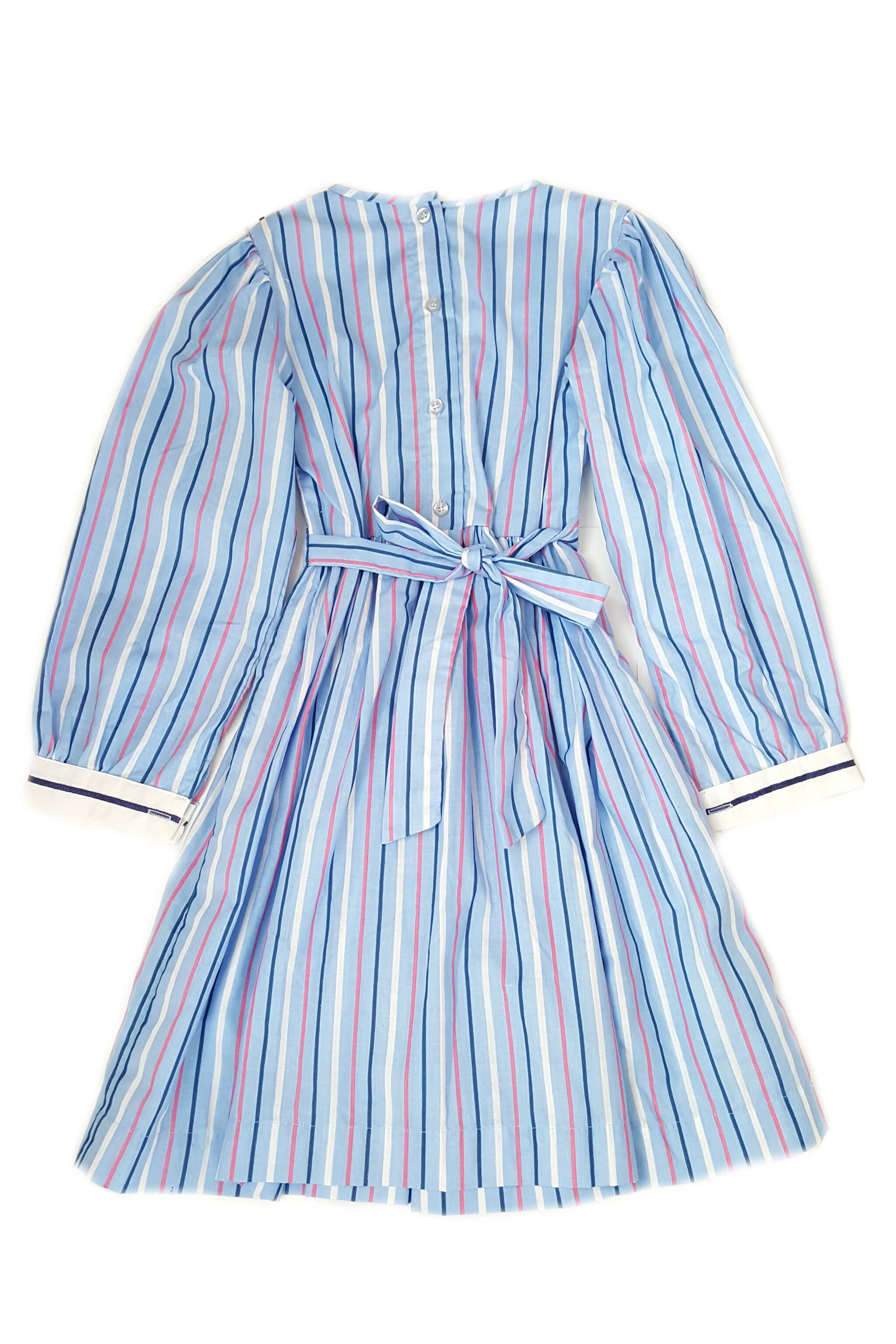 Sky blue, pink and white candy-stripe smocked dress with button back opening and a sash to tie at the waist