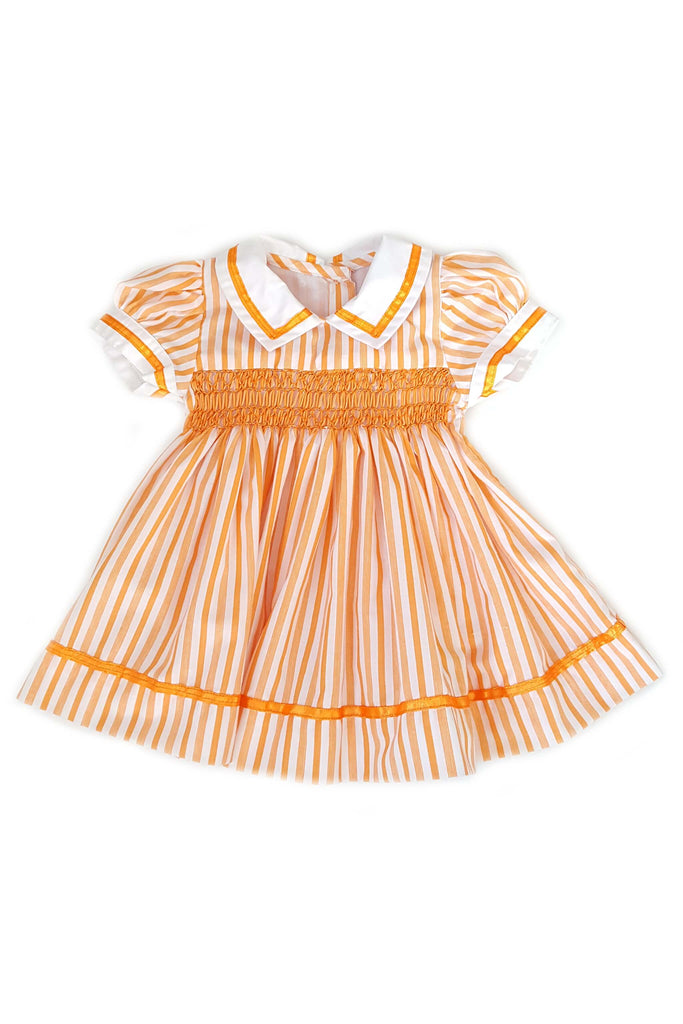 Pumpkin orange striped Pauline dress featuring a nautical white collar with orange trim and hand-smocked bodice