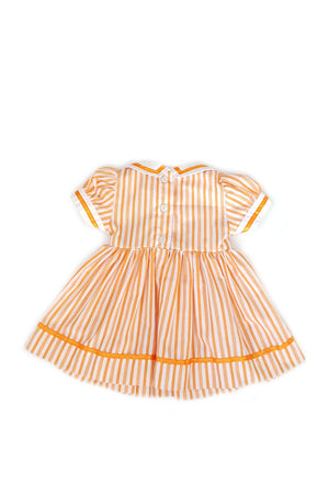 Back of pumpkin orange striped Pauline dress featuring a nautical white collar with orange trim and hand-smocked bodice with button back