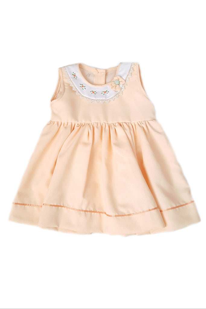Peach colored party dress with hand-embroidered flowers and a large jeweled bow for baby girls