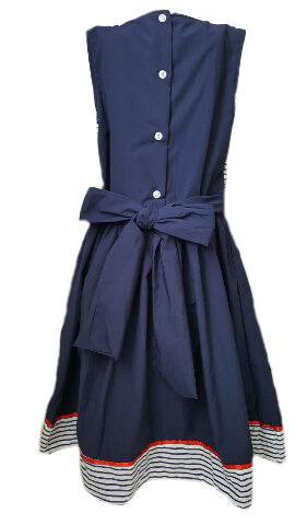 Back of nautical striped navy blue dress with button back and sash to tie at the waist for girls