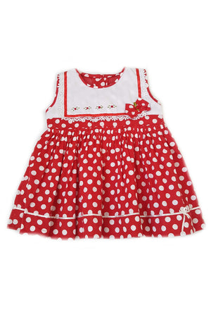 Red polka dot baby girl dress with white bodice and hand-embroidered flowers