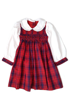 Traditional and classic red and navy plaid smocked dress with contrasting long sleeves featuring plaid cuffs for 2-3 year old girls