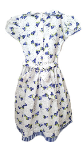 Back of white dress with blue strawberry print and sash to tie at waist for older girls that is ethically made
