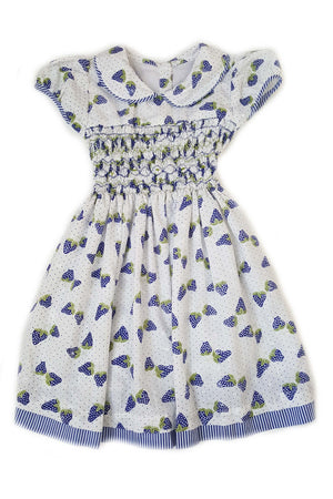 White dress with blue strawberry print and hand-smocked bodice for girls that is ethically made