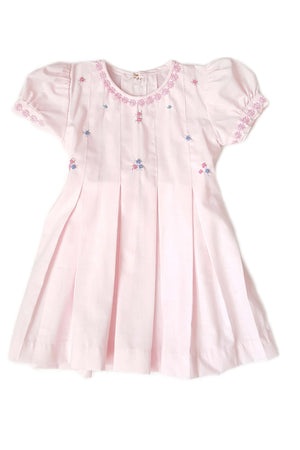 Pastel pink pleated dress with hand-embroidered rosettes along the bodice box pleats cascading down the dress for little girls perfect for flower girl dresses