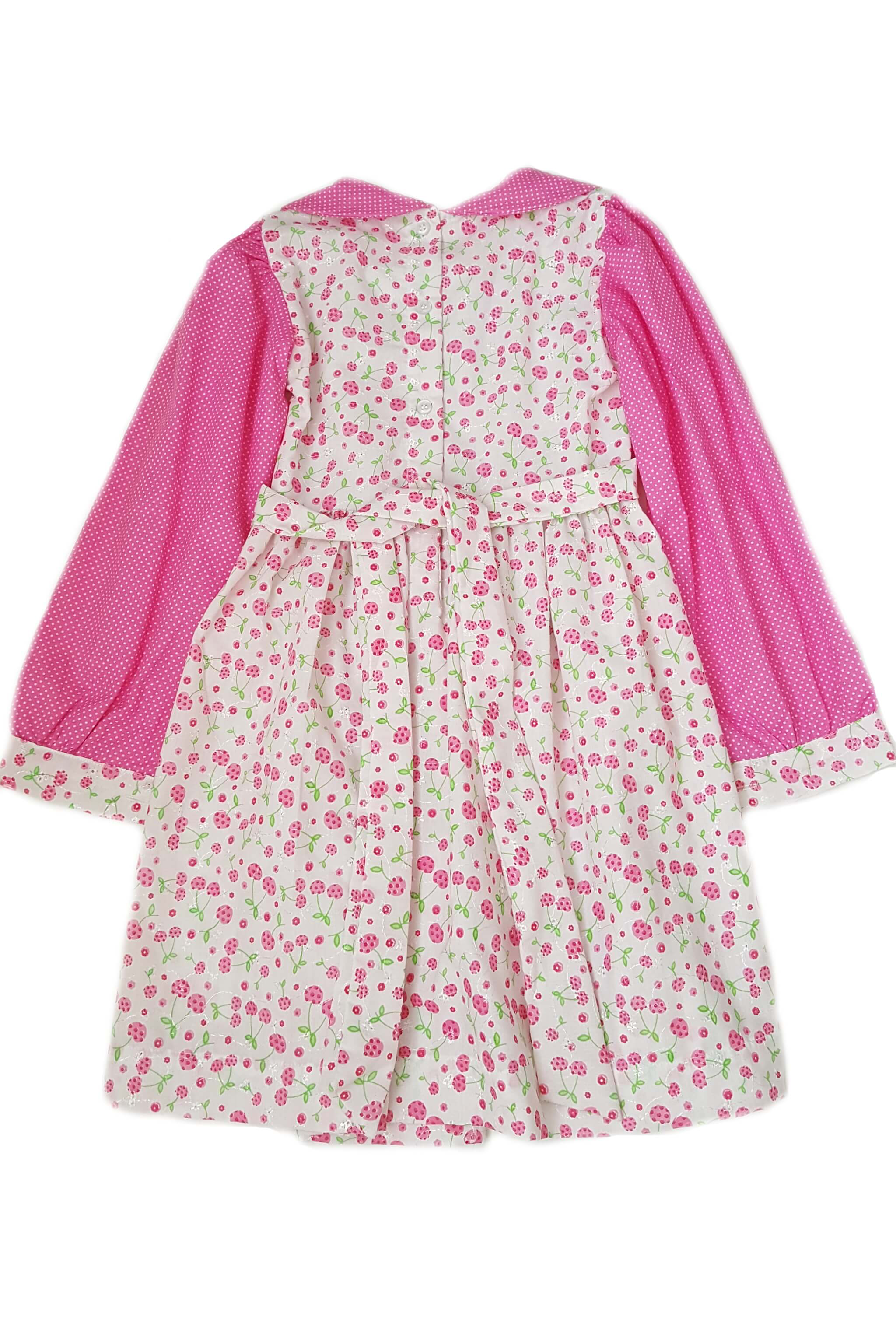 Back of whimsical, fun-loving floral print dress with contrasting sleeves and peter pan collar featuring hand-smocked bodice with button back and sash for girls