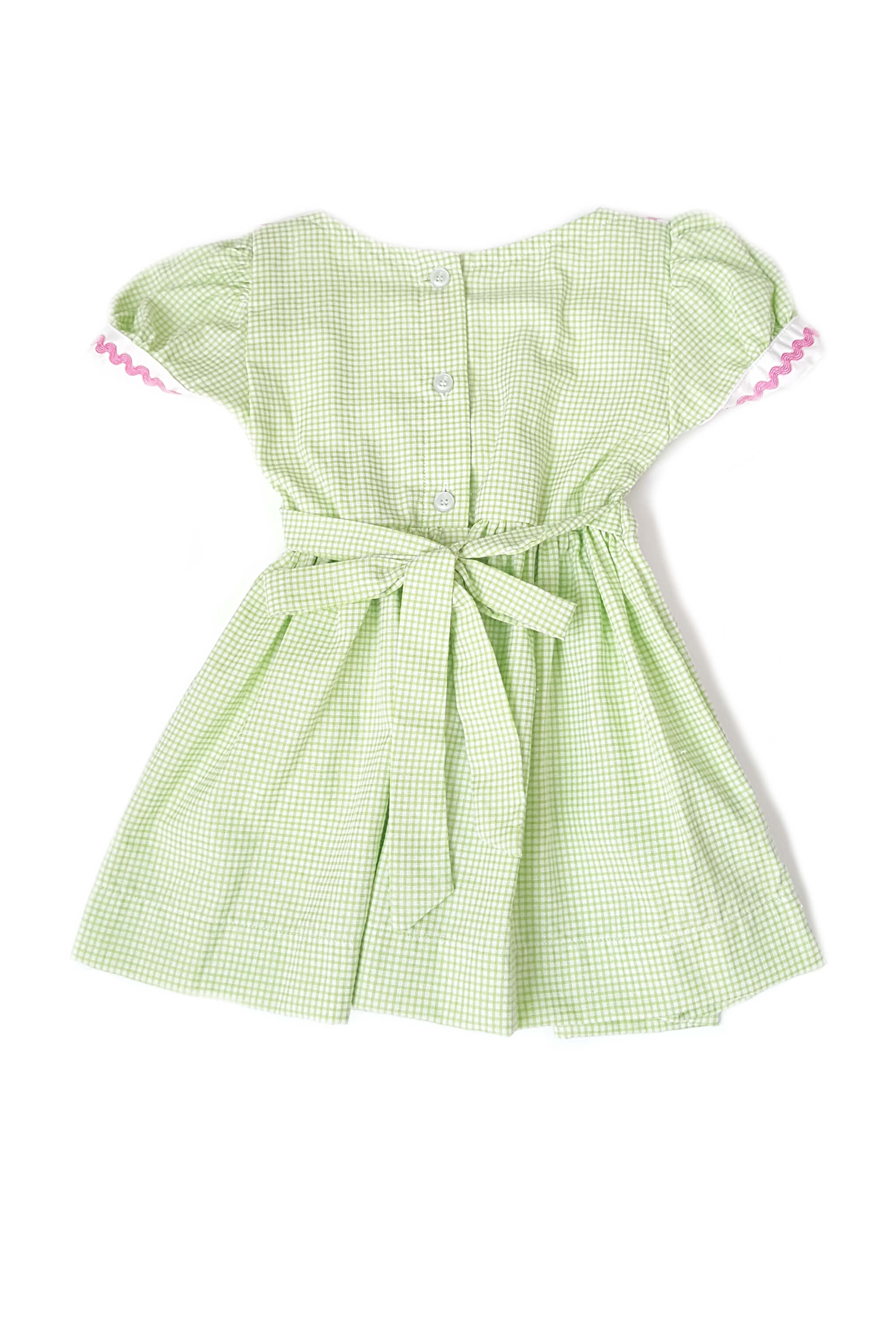 Back of sage green dress with hand-smocked bodice and contrasting white sailor collar and sash for little girls