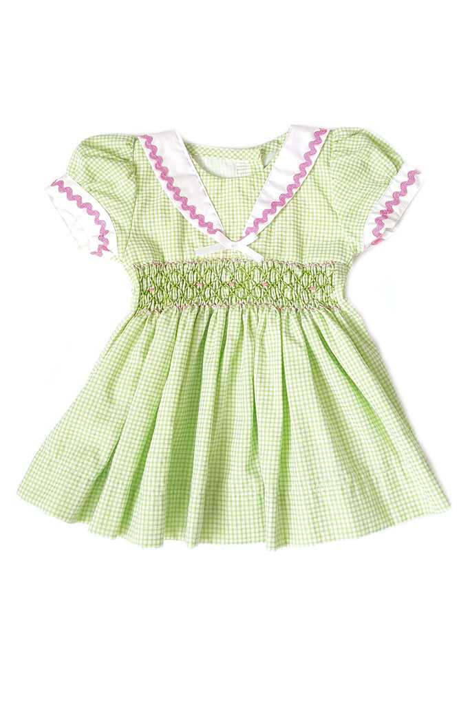 Sage green dress with hand-smocked bodice and contrasting white sailor collar for baby girls