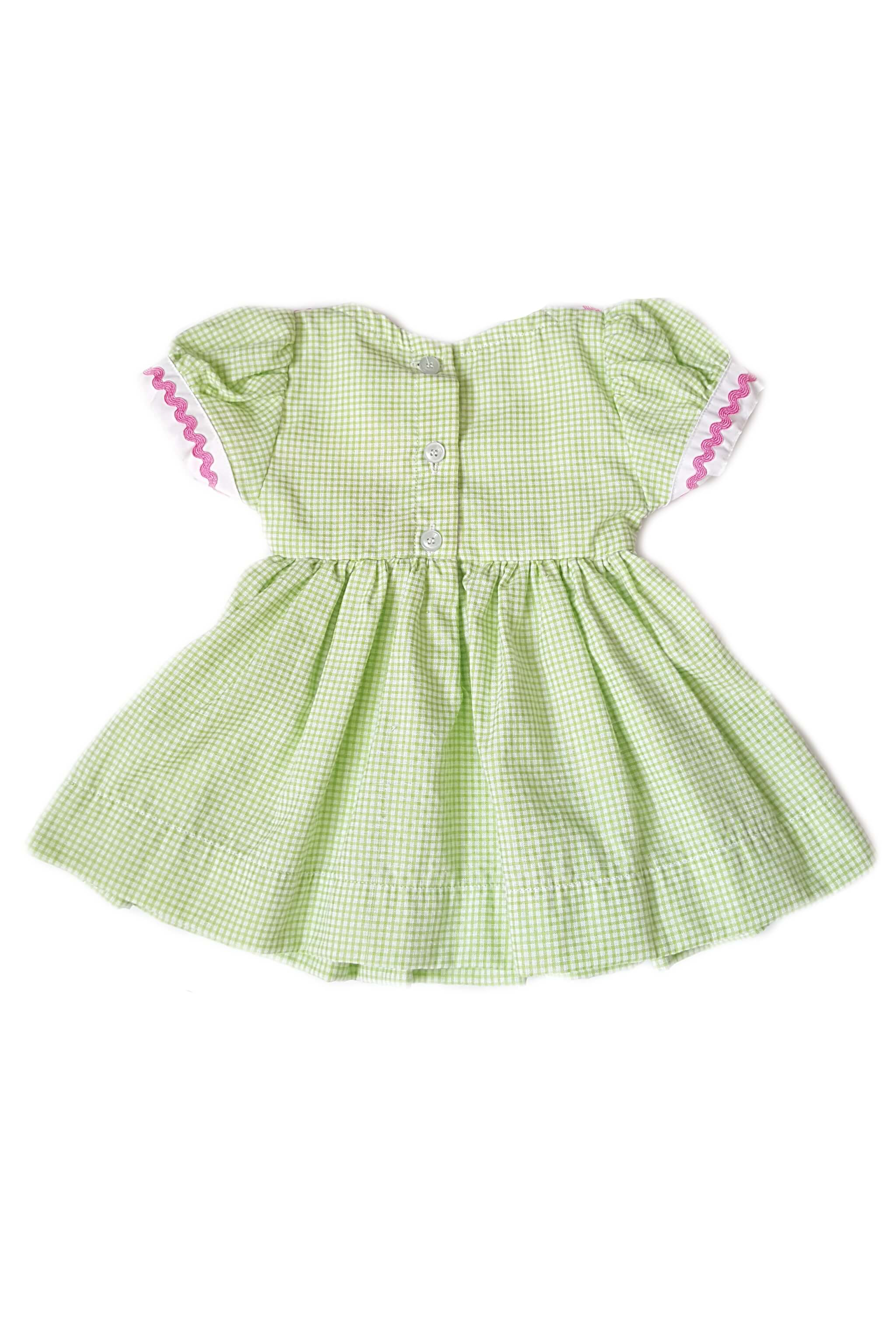 Back of sage green dress with hand-smocked bodice and contrasting white sailor collar with button back for baby girls