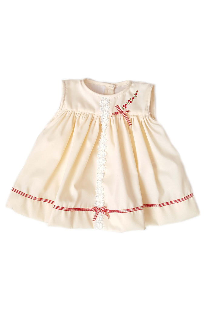 Soft peach dress with hand-embroidered red bouquet of roses and red gingham trim for baby girls