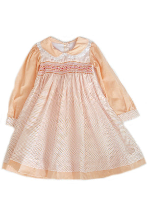 Front of long sleeve Wanda dress with orange pin dots on bodice and contrasting delicate orange pin striped sleeves, collar and trim on hem with varying hand-smocked bodice for girls