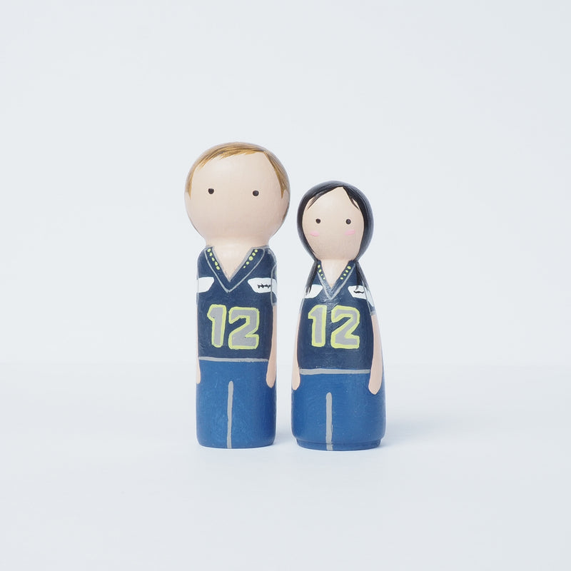 "Give something unique and personalized. Custom peg dolls of your family! They are hand-painted that show the uniqueness of each individual in your family. A 9""x9"" white shadow frame is included with the city landscape of your hometown! This will definitely touch the heart and bring smiles, may be even happy tears of your loved ones.  These are great for parents, grandparent's gifts, birthdays, anniversary gifts, couples' gifts, or any other occasions."