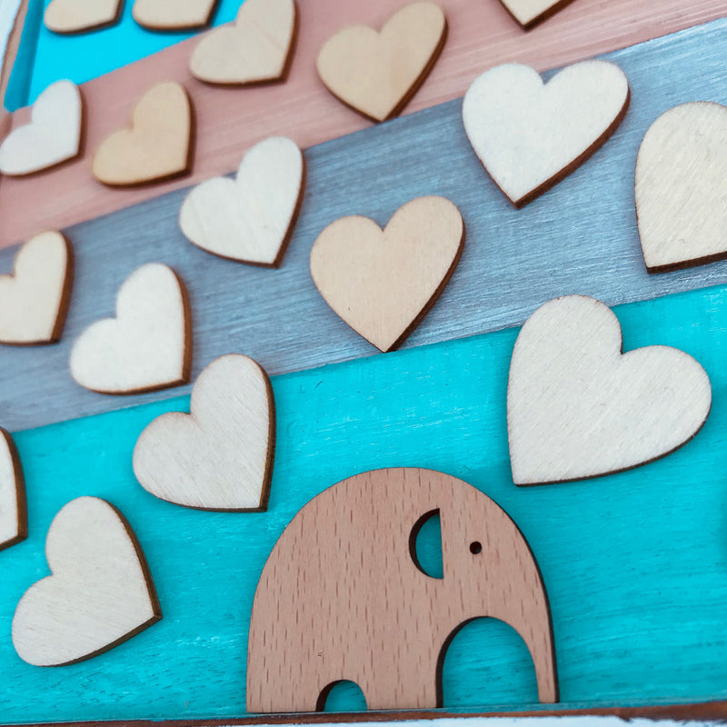 Baby Elephant Guest book Alternative on a Vintage Shutter!   Guest book doesn't need to be boring, it can turn into an art piece and nursery decor!  We add a touch of colour to a vintage-styled shutter.  We can customize the name and colour combination to match the nursery or any theme colour. Have your guests sign a wooden heart and hang this guestbook as an artwork after the baby shower. Great keepsake gift and surely a conversational starter!