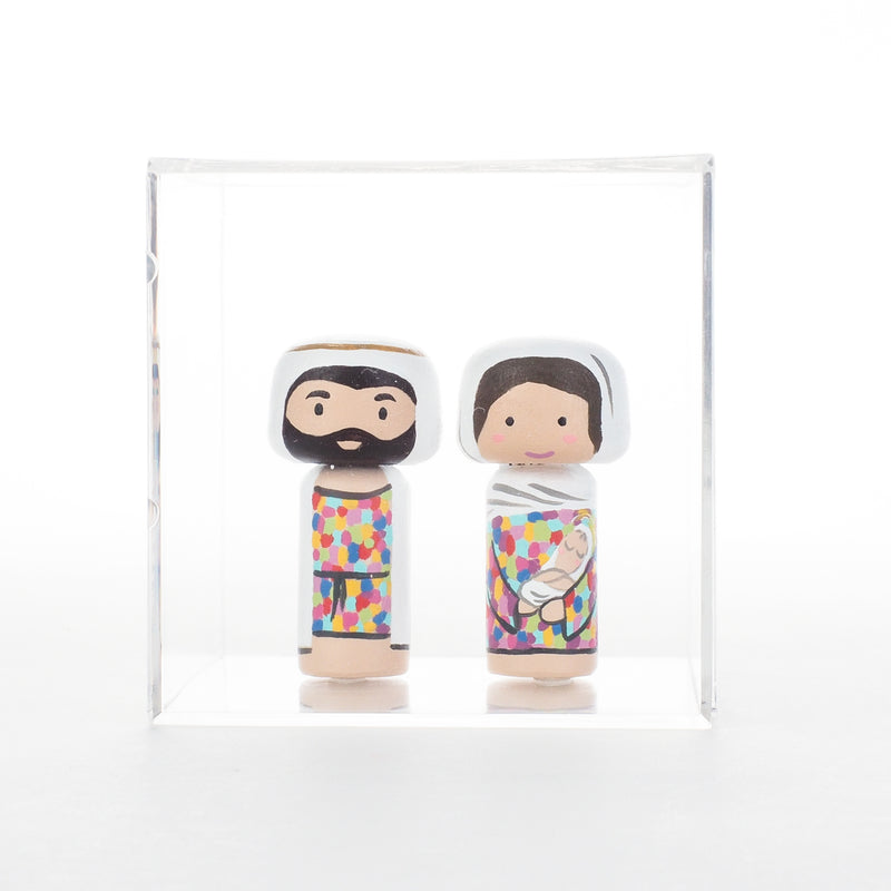 "Jesus is the gift!  Christmas is all about Him.  To honour this special season, I am pleased to introduce this nativity set to celebrate the birth of Jesus.  This tiny nativity set include Baby Jesus with Mary, Joseph.  The colourful attires of Mary and Joseph are inspired by the beautiful stained glass of churches.  The 2 tiny Kokeshi dolls (Baby Jesus with Mary and Joseph) are 6cm or approximately 2.4"" tall, they are less than half of the sizes of our large Kokeshi dolls."