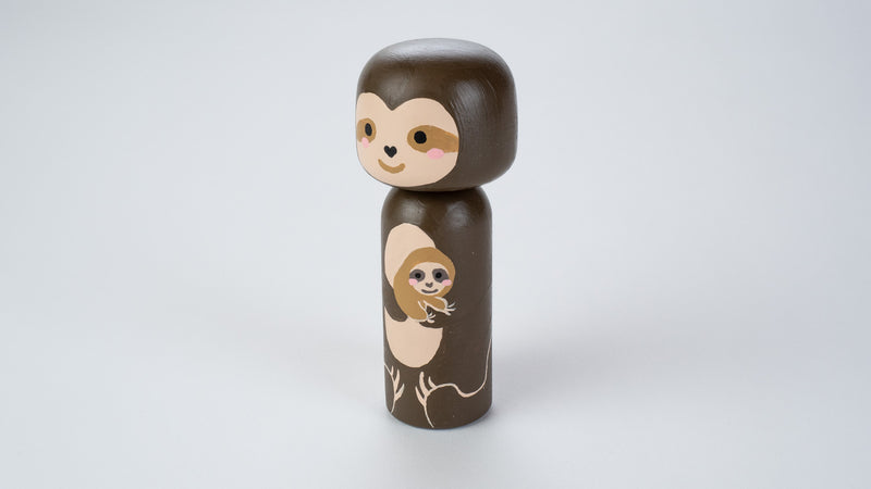 "Sample Sale!  These sample Kokeshi dolls are as-is.  Sloth and baby Sloth Kokeshi doll!  This cute sloth wooden doll will warm your heart or your special someone.  Perfect gift for anyone who are in love with sloth!    All dolls are hand-painted with love.  Collect them all, other animals are also available.  This listing include 1 sloth Kokeshi doll.  The large doll is approximately 5.7"" tall x 2.4"" wide, which is doubled in size of our regular peg dolls."
