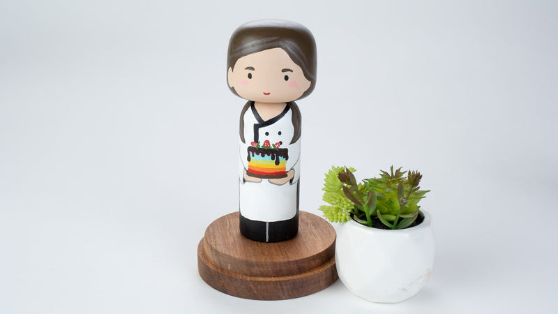 Baker - Hobby and occupational Kokeshi Doll.  Introducing our new hobby and occupational Kokeshi dolls!  Give something unique and personalized.  Customize a hobby or occupation of your family, friends, or colleagues on Kokeshi dolls!  They are hand-painted with love that show the uniqueness of each individual.