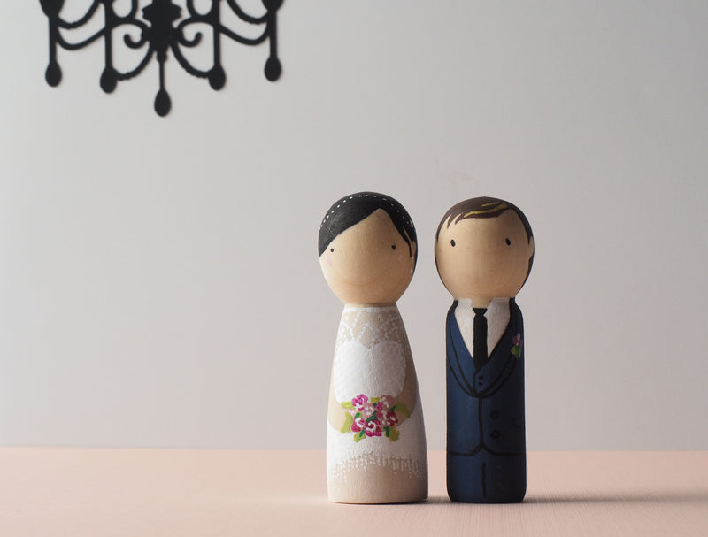 Customized wedding cake topper!  These cute peg dolls show the unique sides of you and your partner.  A great touch of personality to your wedding.  They will WOW your guests.  Also, what a great keepsake it would be!
