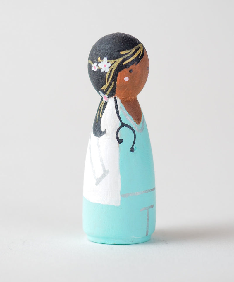 Occupational gift - Doctor Peg Dolls.  Give something unique and personalized.  Custom peg dolls of your family, friends, or colleagues!  They are hand-painted that show the uniqueness of each individual with their hobbies or occupations.  This will definitely touch the heart and bring smiles.  These are great for birthdays, anniversary, parent's gifts, grandparent's gifts, retirement, graduations, communion, colleague's going away gift, or any other occasions.