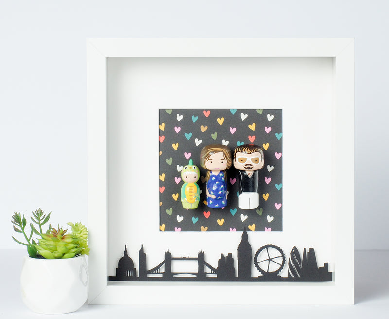 Give something unique and personalized. Custom peg dolls of your family! They are hand-painted that show the uniqueness of each individual in your family. A white shadow frame is included with the city landscape of your hometown! This will definitely touch the heart and bring smiles, may be even happy tears of your loved ones.  These are great for parents, grandparent's gifts, birthdays, anniversary gifts, couples' gifts, or any other occasions.