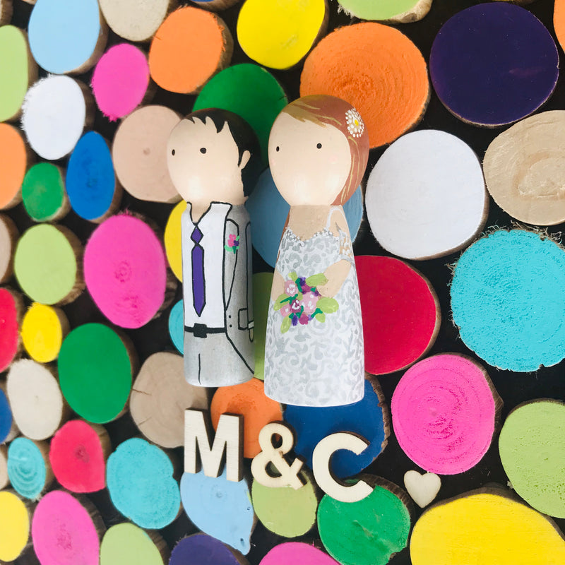 Wooden Wedding guestbook alternative and custom wedding couple on wooden peg dolls! Why pick only a few colours for your wedding theme when you can have the whole world of colours!  Customize your portraits on tiny peg dolls and have your guests sign a wooden disc.  Hang this framed guestbook after the wedding to preserve beautiful memories of the special day for many years to come.
