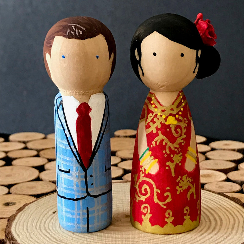 Chinese Wedding Peg Dolls.  Customized wedding cake topper!  These cute peg dolls show the unique sides of you and your partner.  A great touch of personality to your wedding.  They will WOW your guests.  Also, what a great keepsake it would be!  These are also great for anniversary gifts, couples' gifts, bridal showers, or any other occasions.  We hand-paint the peg dolls to match your wedding attires and culture.