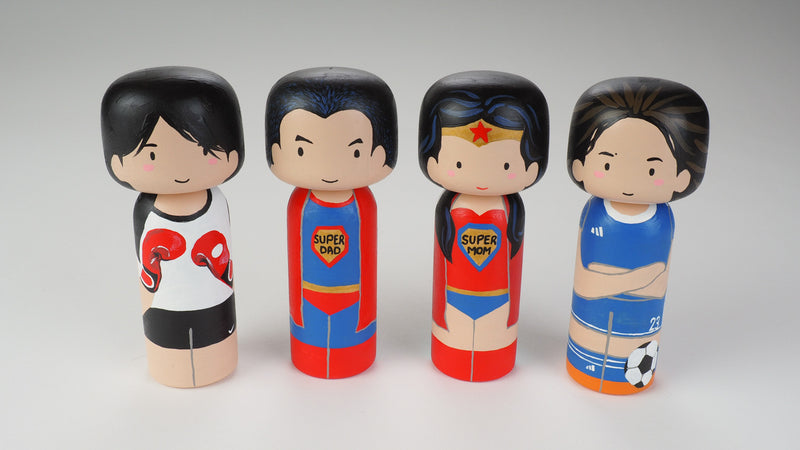 Custom super dad Kokeshi doll!  Introducing our new 2 in 1 family portrait Kokeshi dolls! 2 Designs of the same person hand-painted in 1 doll. Everyone has many roles, interests, careers, personalities, and we all wear many hats in life. Why not highlight and celebrate those in a hand-painted doll! 1 design on one side, turn the doll around and it shows another design. The toughest part is probably to choose the 2 roles you like us to paint.