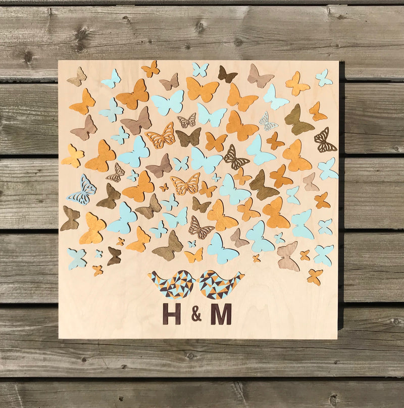"Guest book doesn't need to be boring, it can turn into an art piece! Have your guests sign a wooden butterfly and hang this guestbook as an artwork after the wedding. Great keepsake gift and surely a conversational starter!  This 20""x20"" wooden guest book consists of 70 sign-able wooden butterflies that is suitable for 100 guests."