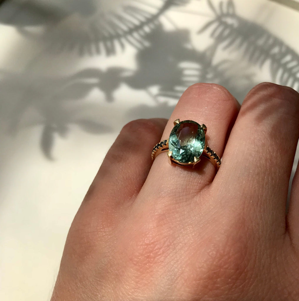 GREEN AQUAMARINE & BLACK DIAMOND RING