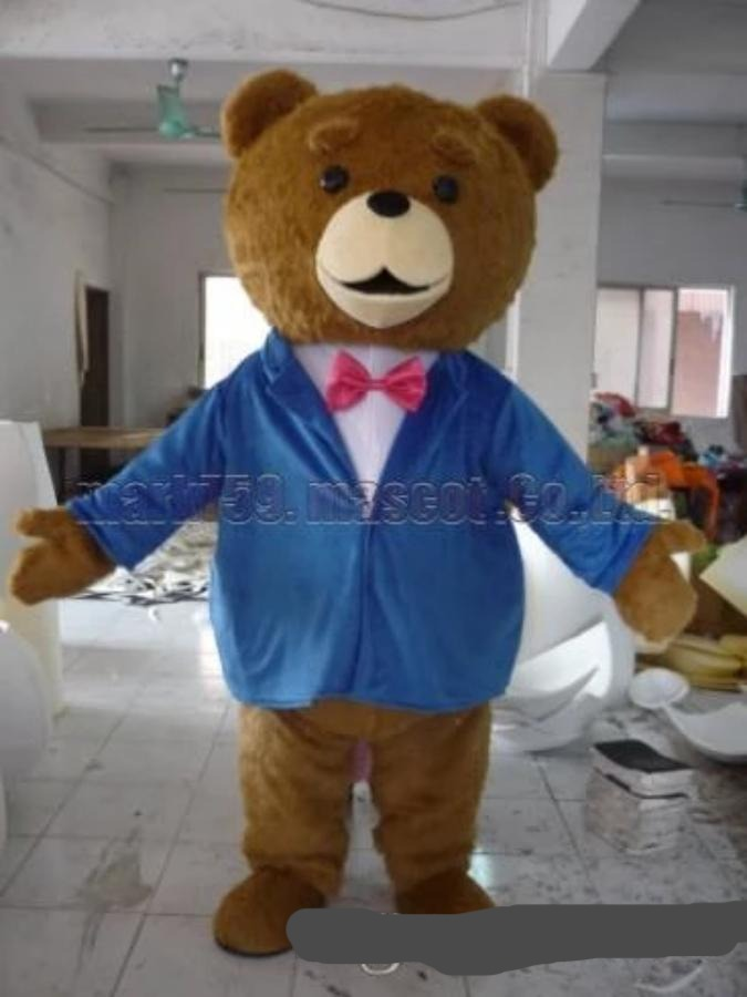 Teddy bear with blue suit