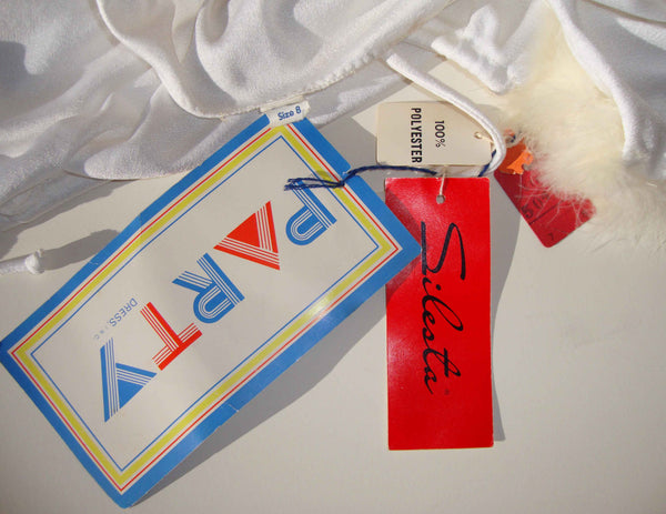 Labels from Vintage 70s White Marabou Dress Gown & Jacket