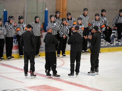 What equipment does a beginner hockey referee need?