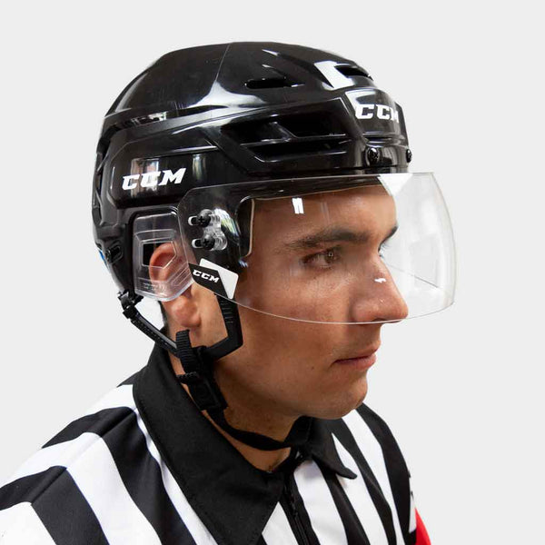 CCM VR24 straight clear hockey referee visor with a ccm resistance 110 black helmet side view