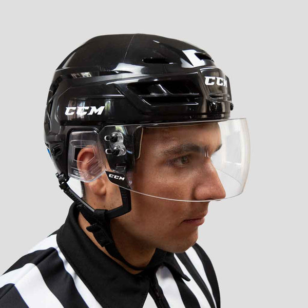 CCM VR25 straight clear hockey referee visor with a ccm resistance 110 black helmet front view