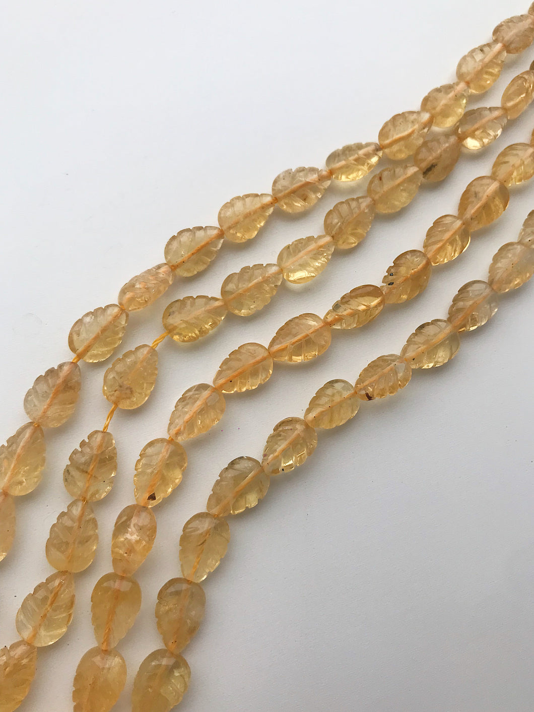 Citrine Carved Leaves 5-6mmx1.5-2mm Drilled Lengthwise