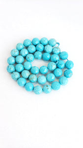 "8MM TURQUOISE HOWLITE FACETED 16"" STRAND"