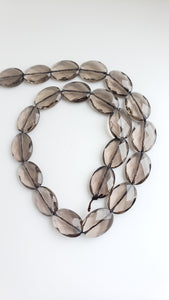"Smokey Faceted Ovals 18x13mm 16"" Strand"