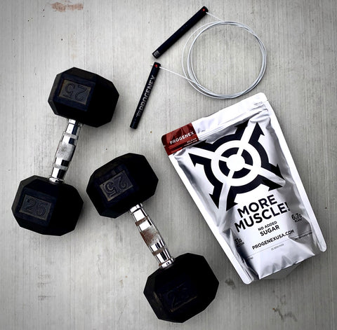 bag of more muscle next to weights and a jump rope
