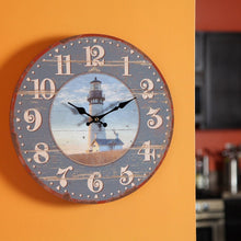 "Load image into Gallery viewer, Lily's Home Rustic Wood-Style Country Lighthouse Wall Clock, Fits Nautical or Country Décor, Battery-Powered with Quartz Movement, Ideal Gift for Lighthouse Fans (13"" Diameter) - zingydecor"