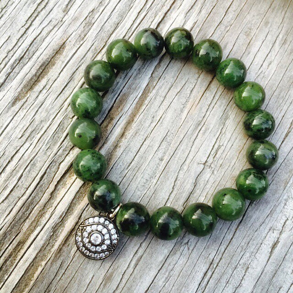 Green jade bracelet with Protection Eye charm