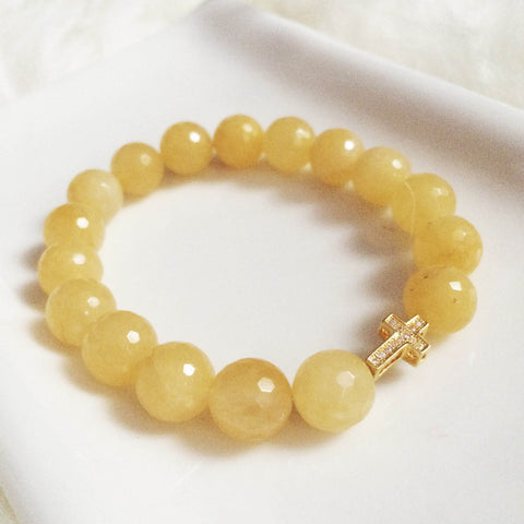 Cross and yellow jade bracelet
