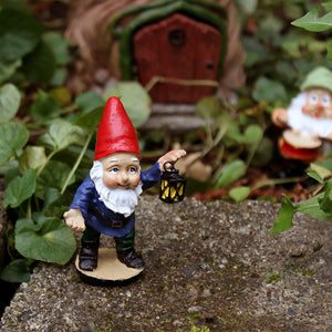 Fairy garden miniature gnome with lantern in fairy garden