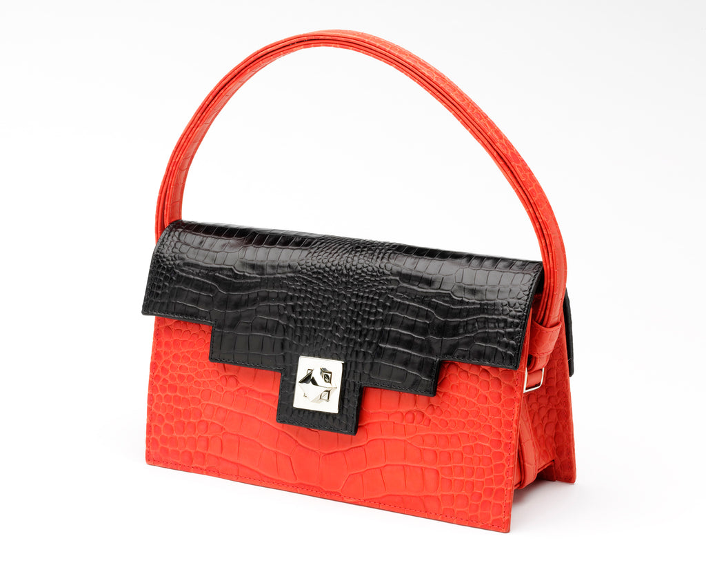 Quoin Medium Handbag in red with black flap