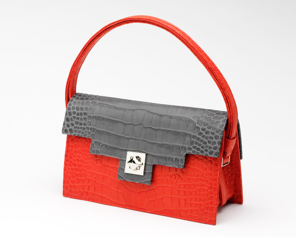 Quoin Medium Handbag in red with grey flap