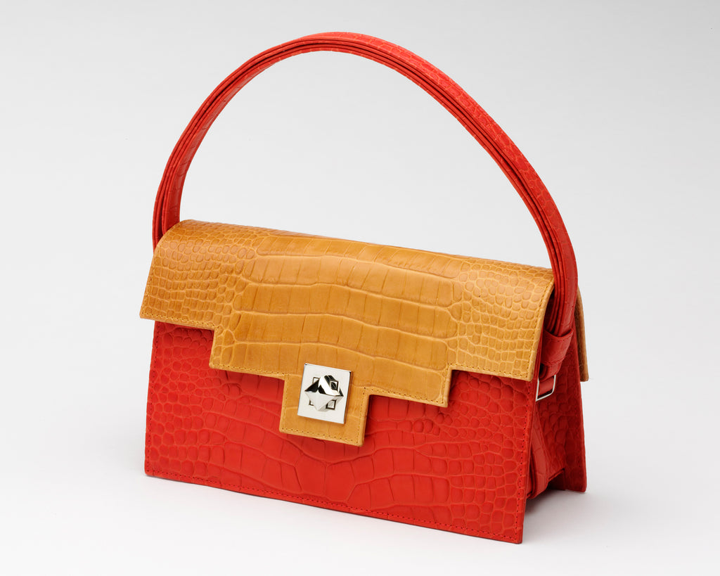 Quoin Medium Handbag in red with tan flap