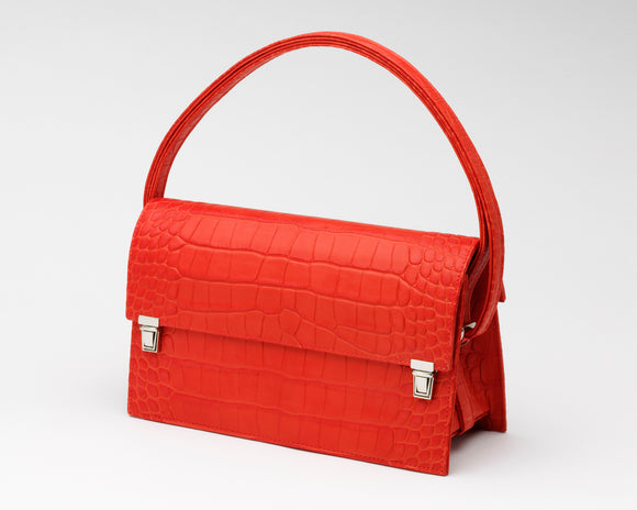 Front of Quoin Medium Handbag in red