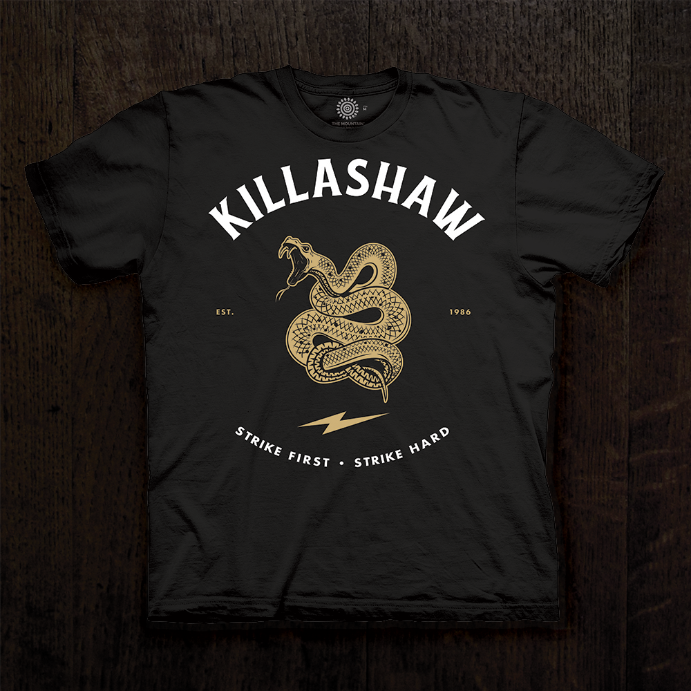 "TJ Dillashaw Men's T-shirt in black. ""Strike First"" design features a snake emblem."