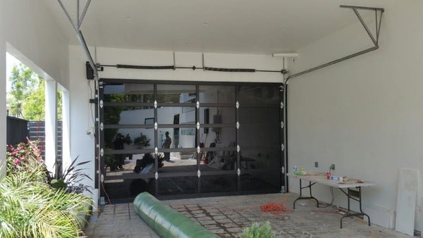 Contemporary Black Aluminum & Black Laminate (Privacy) Glass Garage Door