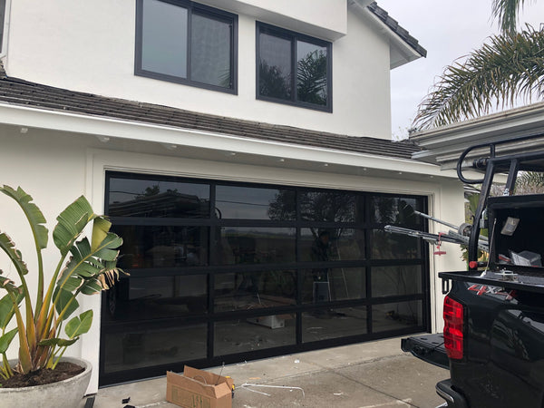 Contemporary Black Aluminum & Gray Tinted (See Through) Glass Garage Door